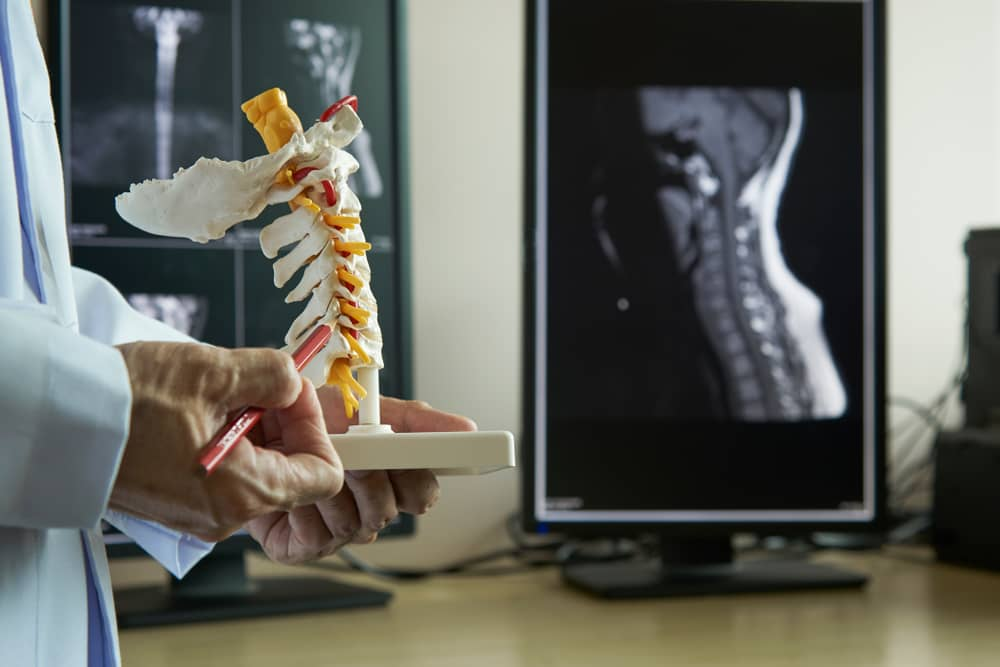 Dr. Jeffrey Gross MD Discusses treatment options for neck pain using a cervical spine model